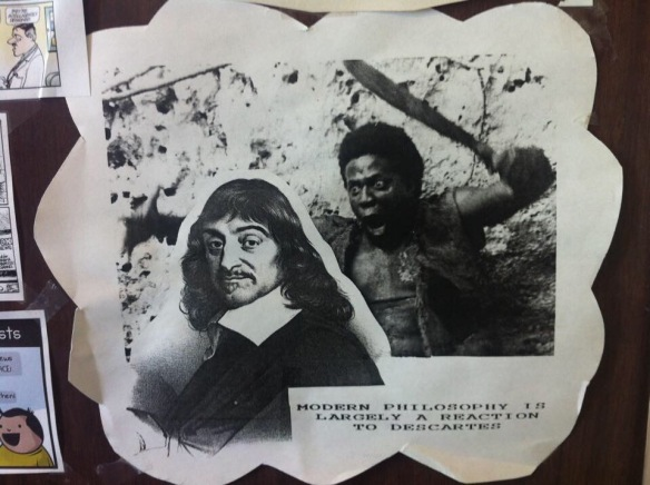 "Photograph of a collage of Rene Descartes, juxtaposed with an image of a black man with a machete, so it appears that Descartes is about to be attacked. Text reads: ""modern philosophy is largely a reaction to Descartes"""